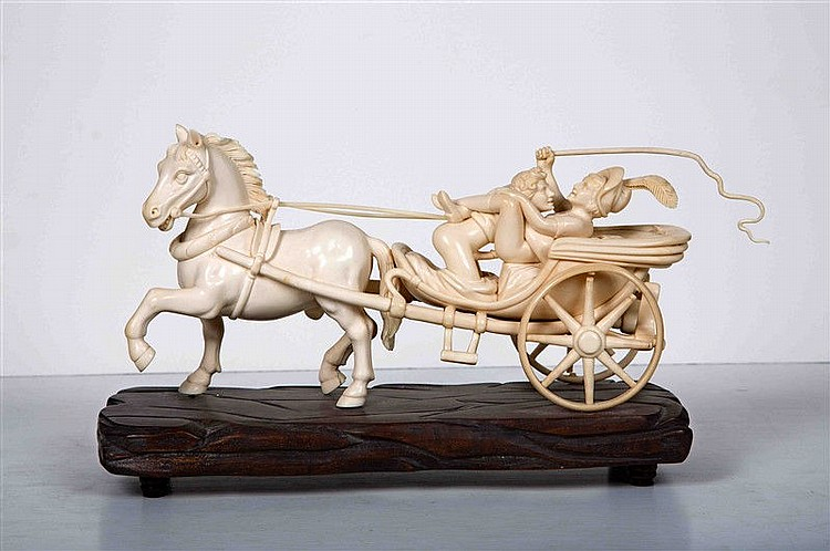 Erotic group carved in mammoth ivory on a wooden base, representing a couple in a carriage drawn by a horse, 19TH CENTURY. Size: 16x26x9.5 cm. It is accompanied by certificate.