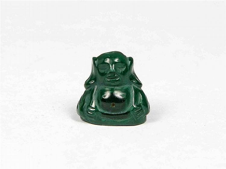 Buddha figure carved in malachite.