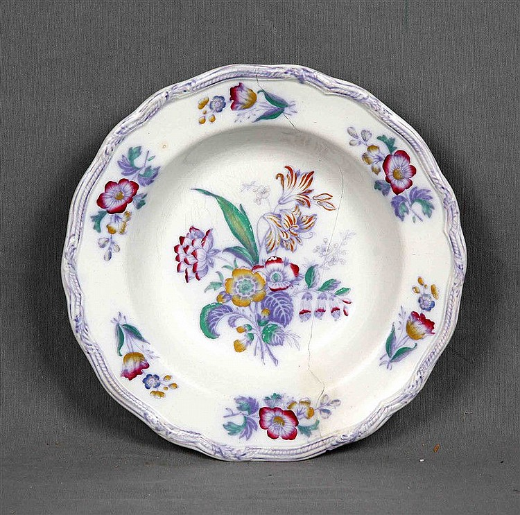 Antique deep bowl in European porcelain HYACINTH PB & H, polychrome and decorated with floral motifs, and irregular wing in relief. Marks and numbering in the base. Diameter: 23.5 cm. (State of conservation: damaged).