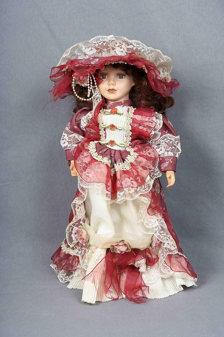 A Polychrome Porcelain Doll