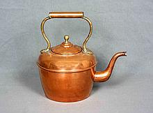 A COPPER AND BRONZE KETTLE