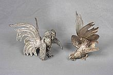 A PAIR OF SILVERED-METAL FIGHTING COCK FIGURES