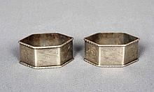 A PAIR OF SILVER NAPKIN HOLDERS