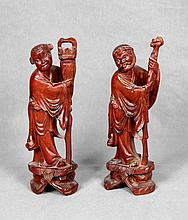 A PAIR OF CARVED ROSEWOOD FIGURES