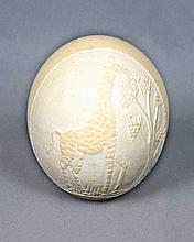 A CARVED OSTRICH EGG