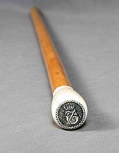A CARVED IVORY AND MALACCA WALKING STICK