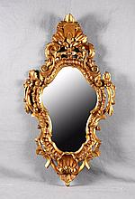 AN ANTIQUE CARVED GILTWOOD AND POLYCHROME MIRROR