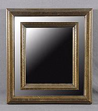 A BRASS AND WOOD MIRROR