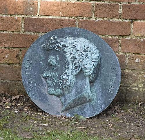 Victor Adam: A bronze portrait roundel signed and