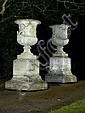 After Girardon: A pair of composition stone urns