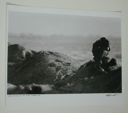 ADAMS, EDDIE Israeli Soldier on the Suez. Silver print, 1973; printed later. 495x324 mm; 19 1/2x12 3/4 inches. Signed, titled and dated, in ink, on recto. Estimate