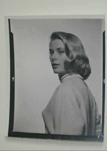 HALSMAN, PHILIPPE Grace Kelly. Silver print, 1950s. 130x100 mm; 5 x 4 1/2 inches. With Halsman's hand stamp and notations, in an unidentified hand, on verso. Estimate