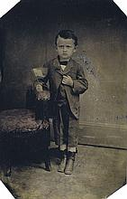 (AMERICAN TINTYPES) Group of 11 patriotic tintypes shot in different photographers' studios, with images of children holding the