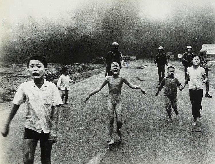 UT, NICK (1951- ) Pulitzer Prize-winning photograph of children fleeing a napalm strike, South Vietnam.