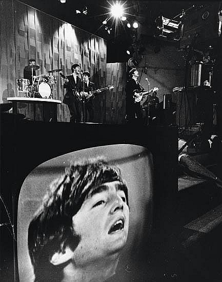 ADAMS, EDDIE (1933-2004) The Beatles (with a close up of John Lennon on a monitor).