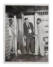 (CIVIL RIGHTS.) Press photo of prisoner Heywood Patterson, one of the Scottsboro Boys, talking with the sheriff.