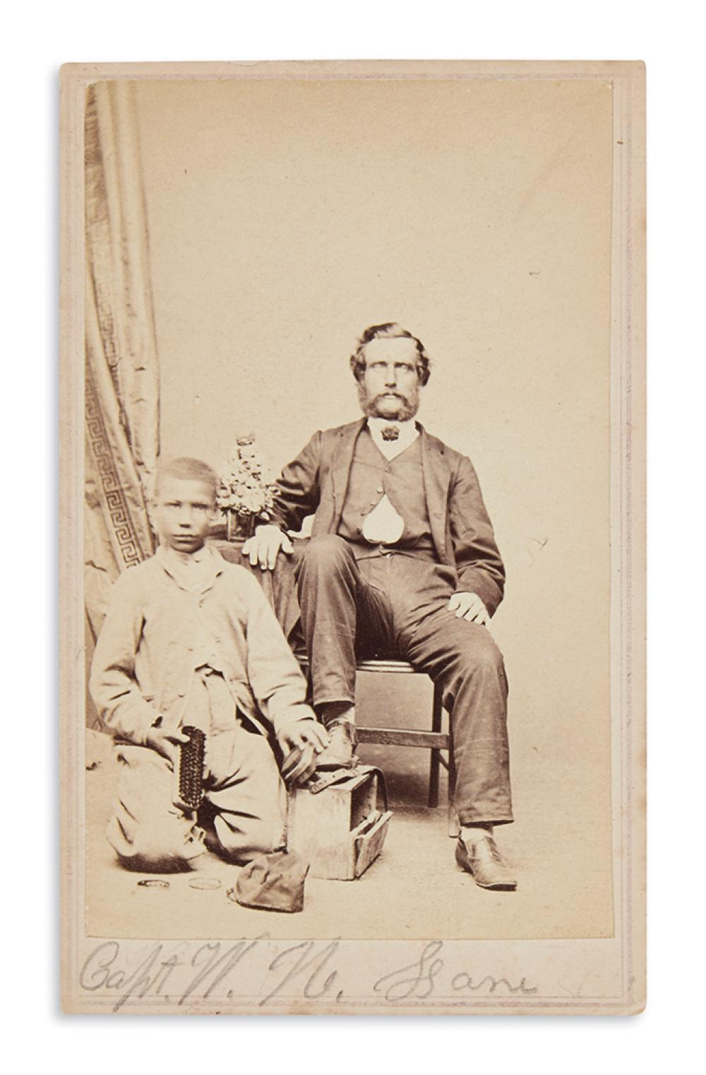 (PHOTOGRAPHY.) Holmes; photographer. African-American shoe shine boy with Capt. W. N. Lane.