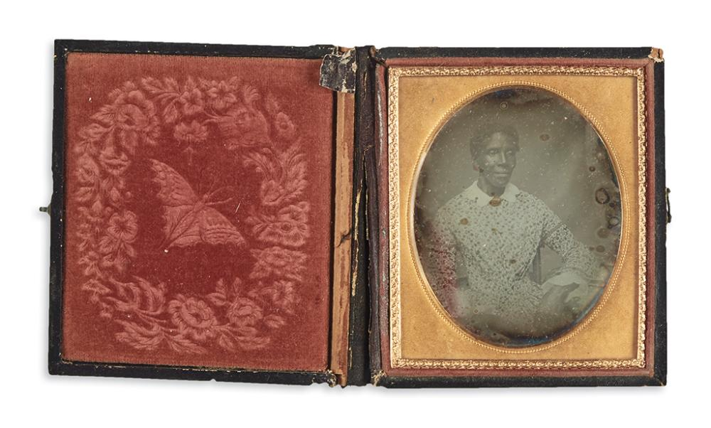 (PHOTOGRAPHY.) Daguerreotype portrait of an African-American woman.