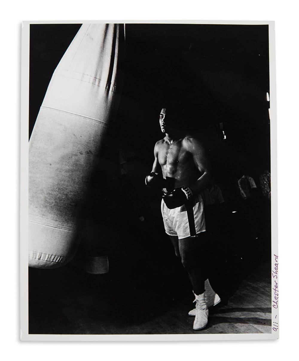 (SPORTS--BOXING.) Sheard, Chester. Photograph of Muhammad Ali training in his prime.