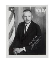 (ASTRONAUTS.) ARMSTRONG, NEIL. Photograph Signed, half-length portrait, showing him wearing a business suit with hands folded in lap an