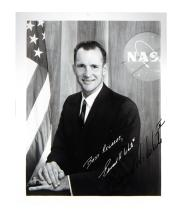 (ASTRONAUTS.) WHITE, EDWARD H. Photograph Signed, half-length portrait, showing him wearing a business suit with hands folded on knee a