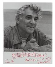 BERNSTEIN, LEONARD. Photograph with an Autograph Musical Quotation Signed and Inscribed,
