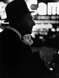 """PAULIN, FRANK (1926- ) """"Lovers"""" (Times Square, New York City)."""