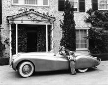 SID AVERY (1918-2002) Humphrey Bogart, Lauren Bacall, and their son, Stephen, in front of their home in Holmby Hills, in Bogie's XF 12