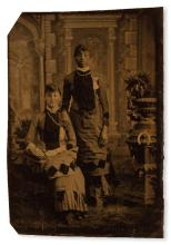 (PHOTOGRAPHY--EARLY AND CASED IMAGES.) Photograph of black and white seamstresses, apparently business partners (supplied title).