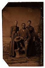 (PHOTOGRAPHY--EARLY AND CASED IMAGES.) A black man posed with two women; one white, the other possibly mixed.