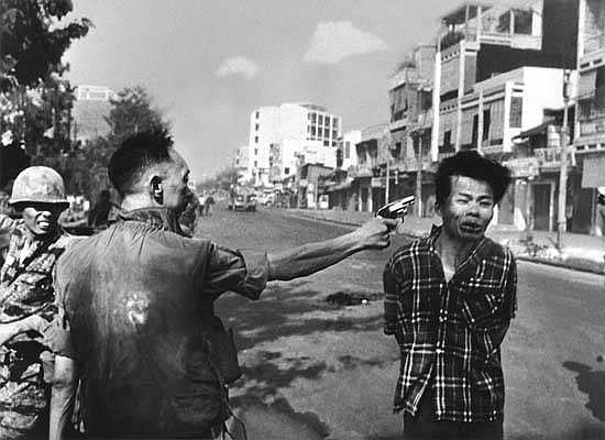 ADAMS, EDDIE (1933-2004) Saigon (General Nguyen Ngoc Loan executing a Viet Cong prisoner Nguyen Van Lém).