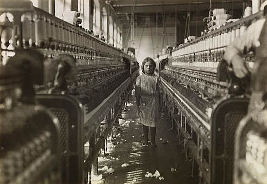 HINE, LEWIS W. (1874-1940) Young spinner at looms.
