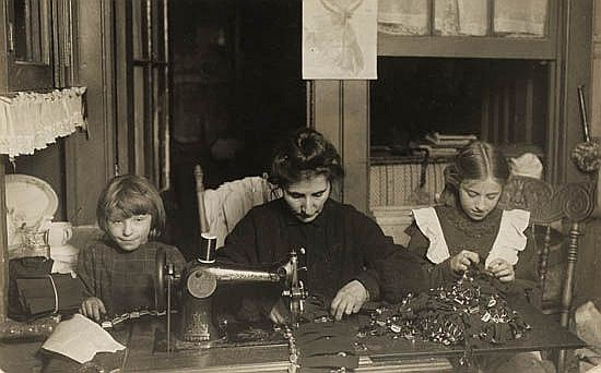 HINE, LEWIS W. (1874-1940) Woman and two girls sewing at home * Family at home.