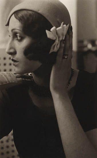 LARTIGUE, JACQUES HENRI (1894-1986) Renée Perle with hand on hat.