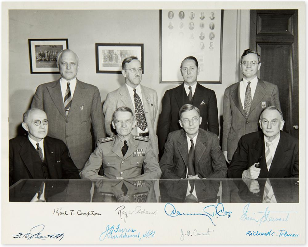 (SCIENTISTS.) Group Photograph Signed, by 8 members of the executive committee of the National Defense Research Committee,