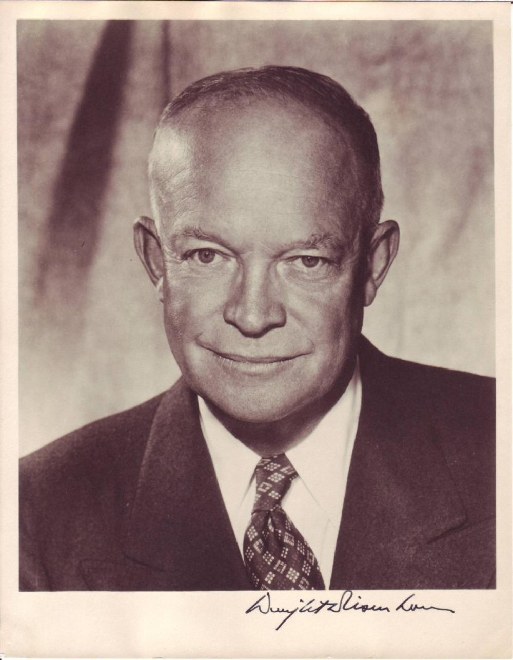 EISENHOWER, DWIGHT D. Photograph Signed, bust portrait showing him looking into the camera.