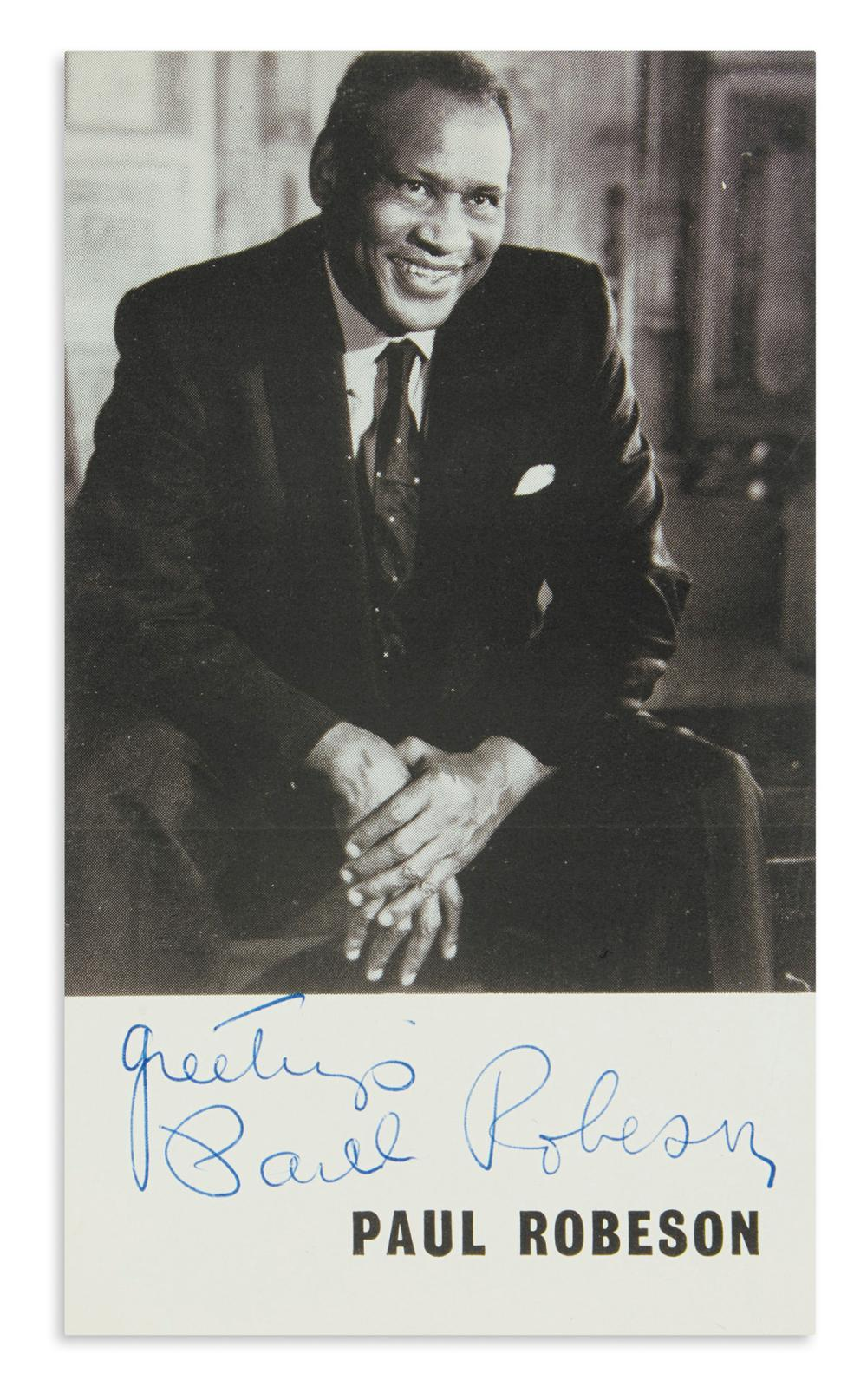 "ROBESON, PAUL. Photograph Signed and Inscribed, ""greetings,"" half-length portrait showing him laughing."