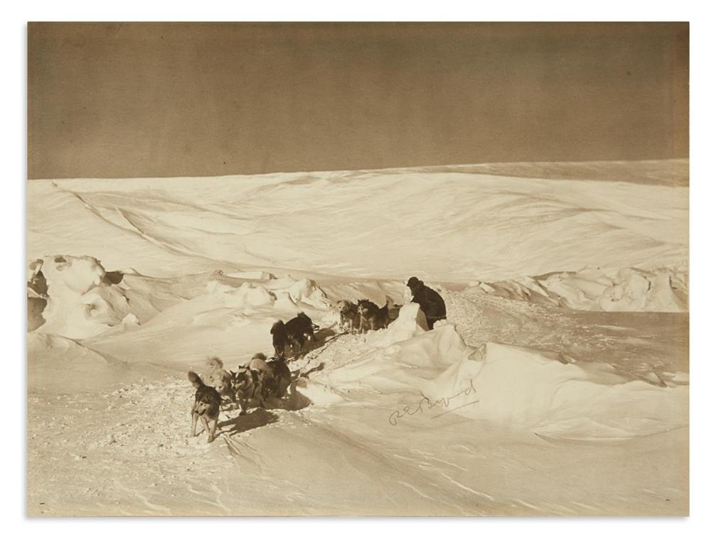 "BYRD, RICHARD E. Large Photograph Signed, ""REByrd,"" showing him with his dogsled on the ice."