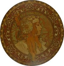 D''APRÈS ALPHONSE MUCHA (1860-1939). [TÊTES BYZANTINES.] Two decorative metal plates. Circa 1900. Each with a diameter of 16 inches, 40