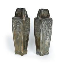 D''APRÈS ALPHONSE MUCHA (1860-1939). [TWO SILVER - PLATED VASES.] Circa 1905. Each 9x3x2 inches, 24x7x6 cm.