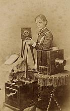 FRIESE-GREENE, WILLIAM (1855-1921) Carte-de-visite of a woman photographer, who is posing with three cameras