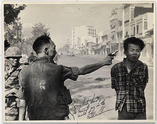 ADAMS, EDDIE (1933-2004) General Nguyen Ngoc Loan executing Viet Cong prisoner Nguyen Van Lém, Saigon.