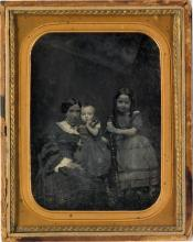 (VICTORIAN FAMILIES) Group of 21 strong portraits of American and British family groups.