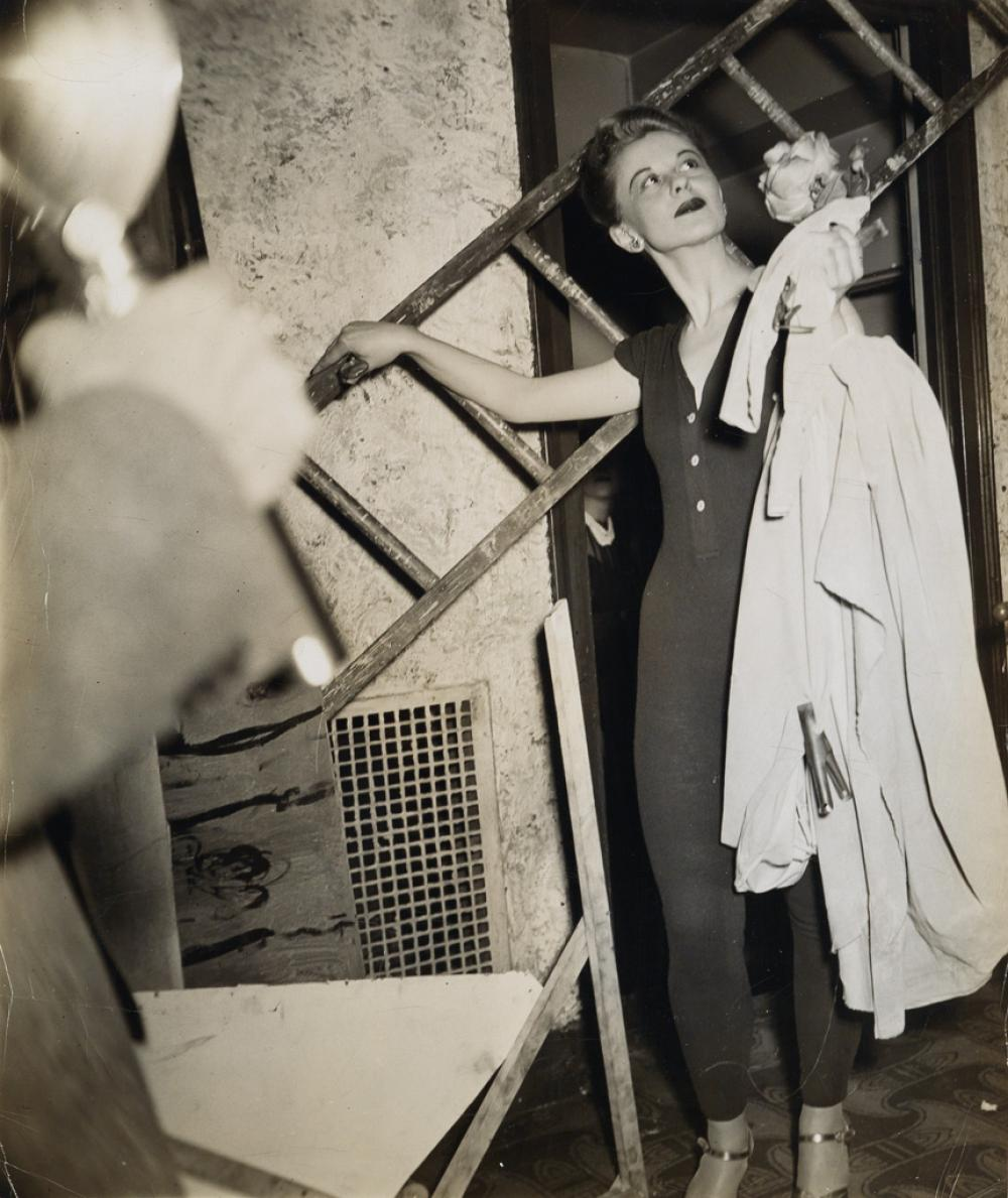 WEEGEE [ARTHUR FELLIG] (1899-1968) Photographer shooting an actress.