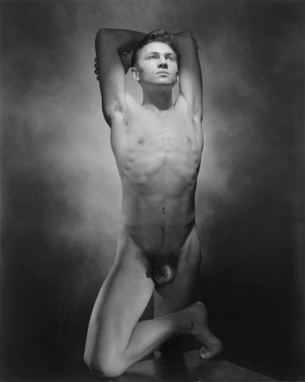 GEORGE PLATT LYNES (1907-1955) Male nude with arms raised.