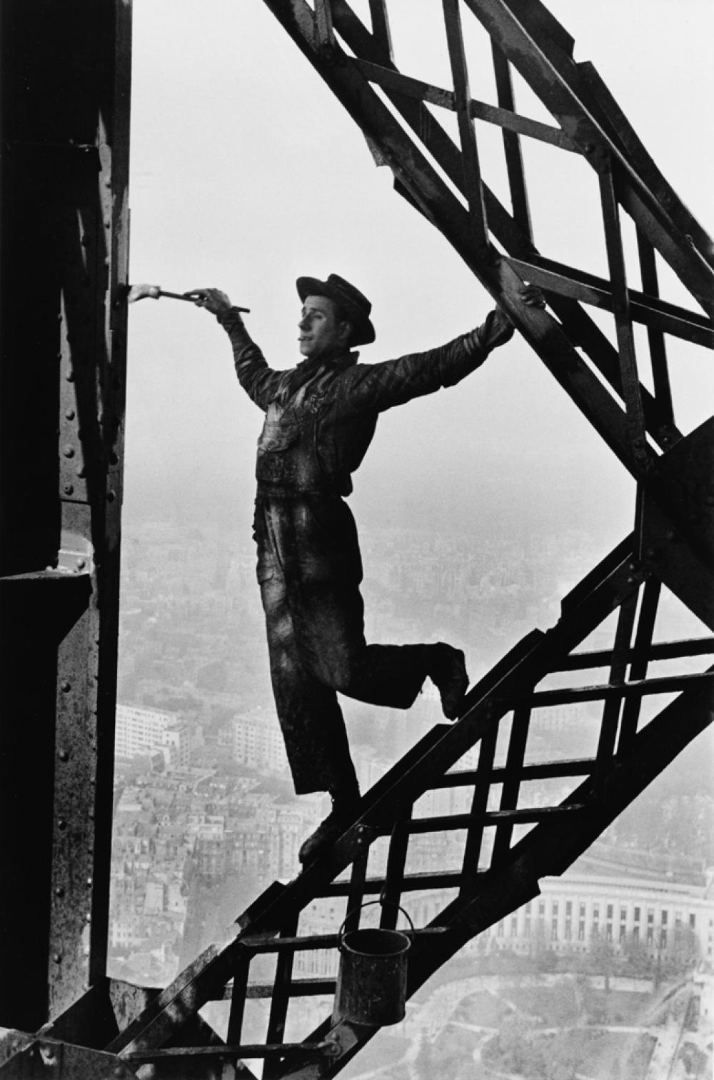 MARC RIBOUD (1923-2016) Painter on the Eiffel Tower, Paris.