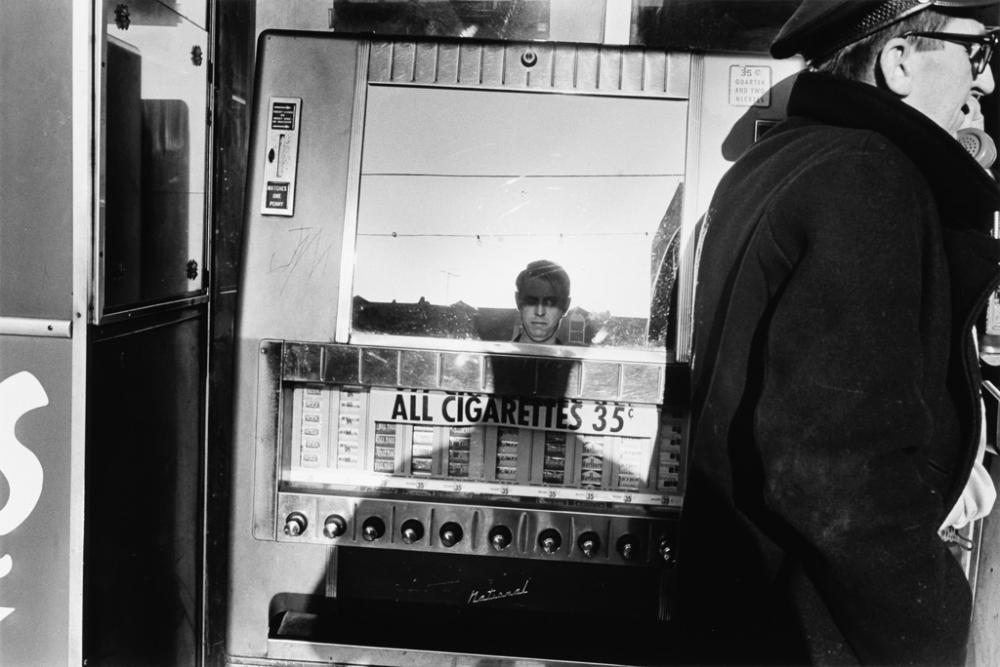 LEE FRIEDLANDER (1934- ) New Orleans (Cigarette machine self-portrait).