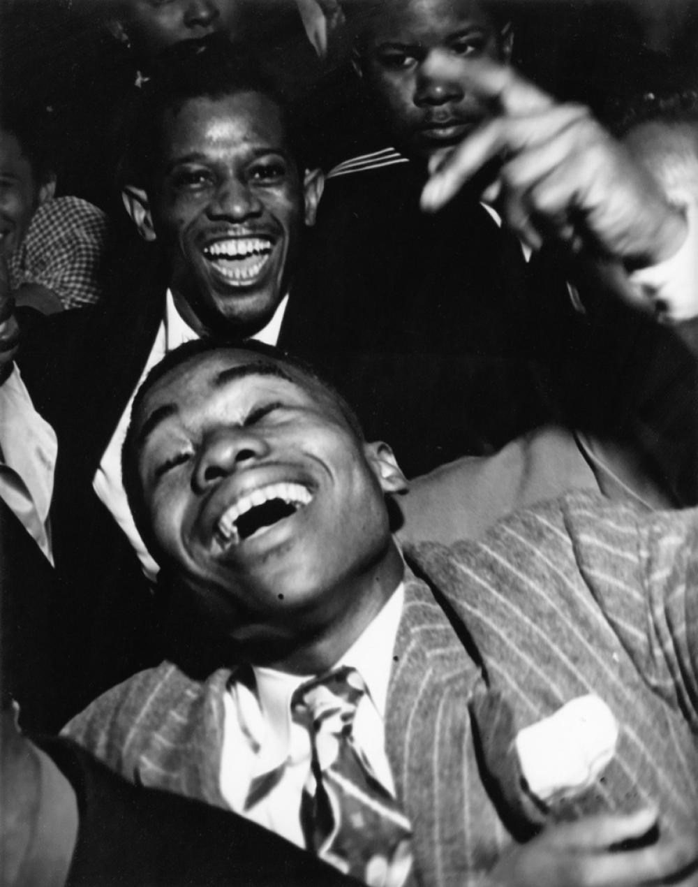 WEEGEE [ARTHUR FELLIG] (1899-1968) African American men in a club.