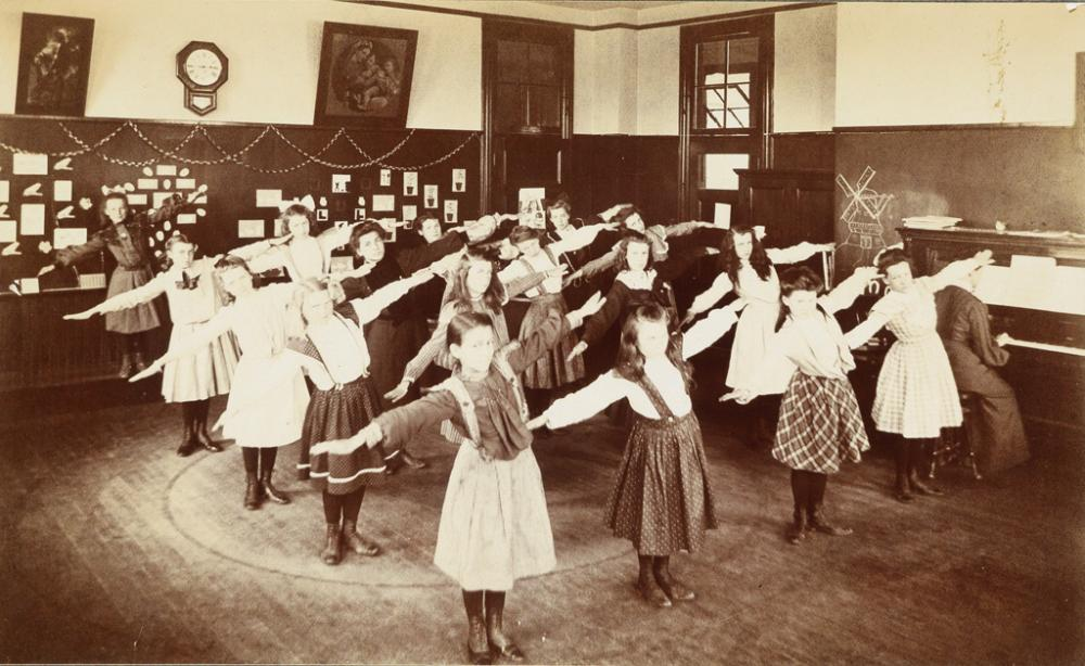 (CHILDREN) A group of 52 photographs of children, many depicting them engaged in calisthenics.