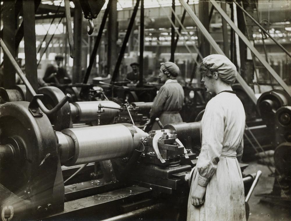(WORLD WAR I--WOMEN'S WORK) A mini-archive of 20 World War I-era photographs of British women at work, many of whom are operating heav